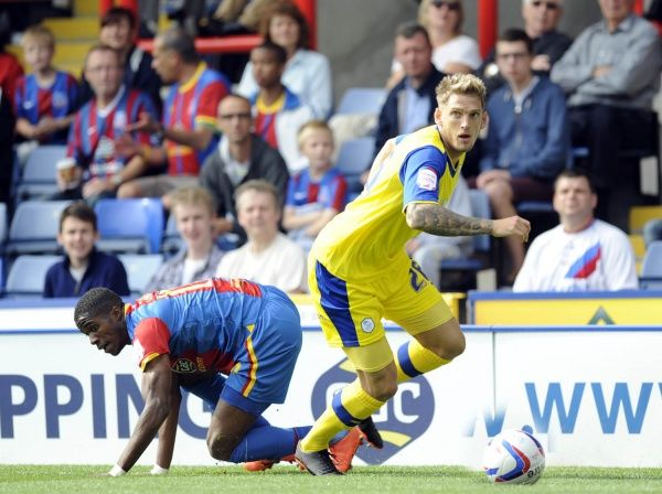 C.Palace v Owls.Lewis Buxton with Wilfried Zaha