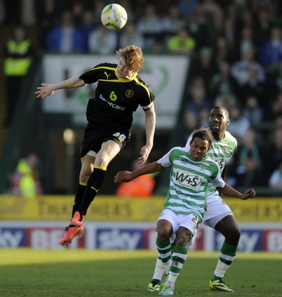 Yeovil v Sheffield Wednesday......Owls skipper Glenn Loovens clears from Yeovil pair of Holmes and Miller