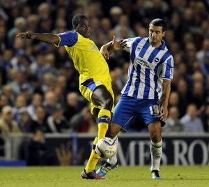 Brighton v Sheffield Wednesday....Owls Michail Antonio holds off Albions Gary Dicker