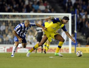 Brighton v Sheffield Wednesday....Gary dicker hangs onto Jay Bothroyd
