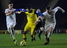 MK Dons v OwlsGary Madine blocked by Dons pair of Williams and Mackenzie