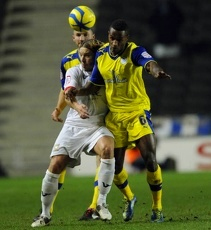 MK Dons v Owls..Jose Semedo blocks out Dons Alan Smith