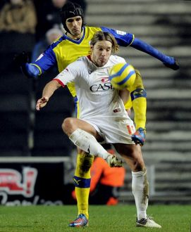 MK Dons v Sheffield Wednesday.....Dons man of the match Alan Smith with Owls Migul Llera