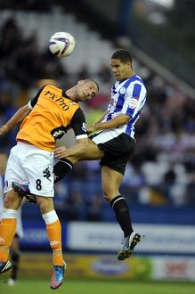 Sheffield Wednesday v Fulham......Giles Coke beats Pajtim Kasami