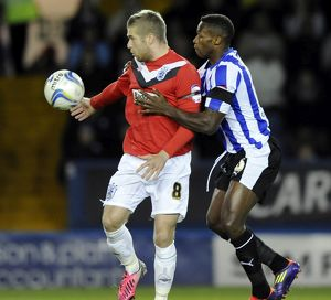 Sheffield Wednesday v Huddersfield....Jose Semedo holds off Adam Clayton