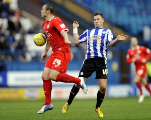 Sheffield Wednesday v MK Dons....Owls Chris Maguire with Anthony Kay