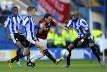 Sheffield Wednesday v Peterborough...Lee Tomlin goes between Corry and Gardner