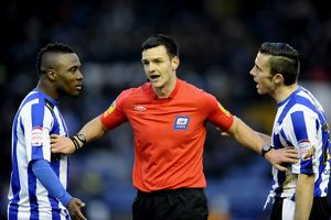 Sheffield Wednesday v Wolves......ref Andrew Madley with Owls Jermaine Johnson and
