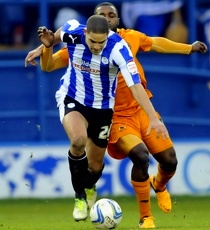 Sheffield Wednesday v Wolves......Owls Giles Coke gets away from Sylvan Ebanks-Blake