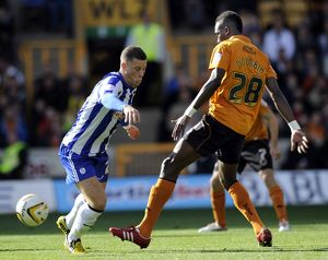 Wolverhampton v Sheffield Wednesday....Owls Ross Barkley with Wolves Tongo Doumbia